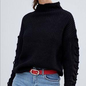 Black turtleneck with braided sleeves